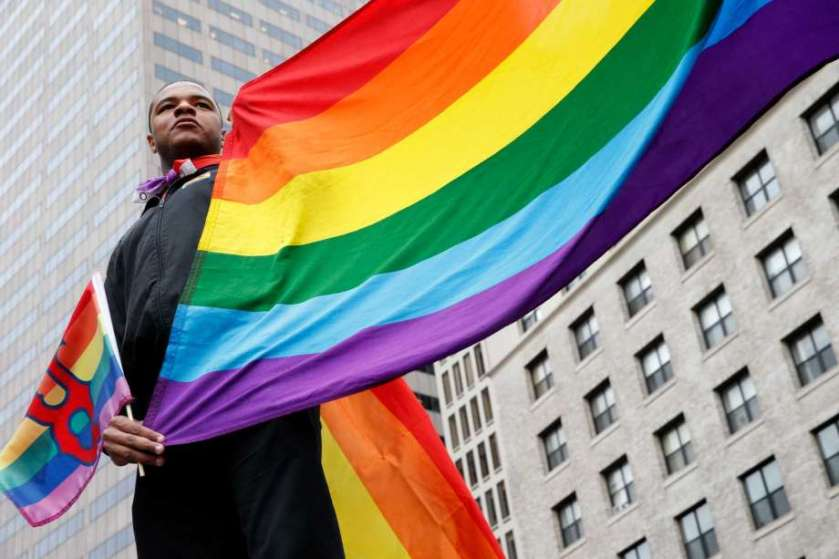 Black man with rainbow flag