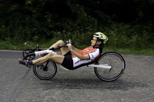 A man on a recumbent bike